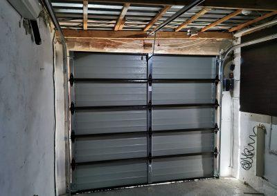 inside garage with single steel garage door