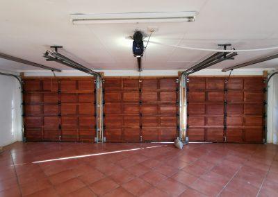 inside garage with wooden garage door